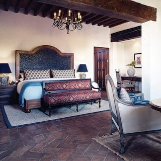 Elegant hotel room with stone tiled floors and Spanish colonial styling