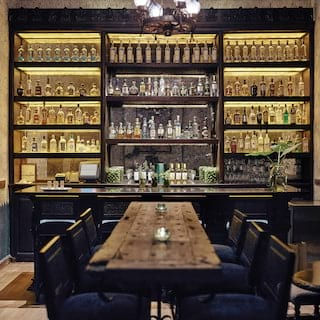 Elegant bar area with rows of tequila bottles on mirrored shelves