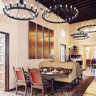 Light and elegant restaurant with Mexican artwork on the walls