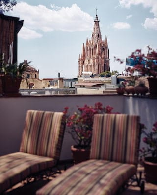 View from a junior suite terrace of church spires in the San Miguel skyline