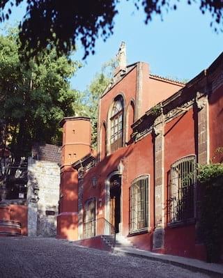 Red-painted building facade with traditional Spanish-colonial architecture