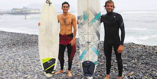 two surfers on the beach