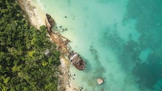 Birds-eye view of a shipwreck in crystal clear waters