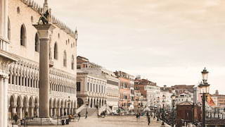 St Mark's Square in Venice lined with ornate building facades