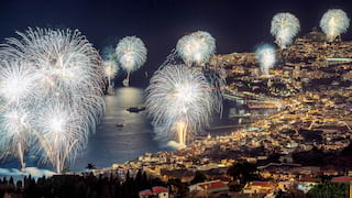A collection of fireworks lighting up the night sky over Funchal Bay