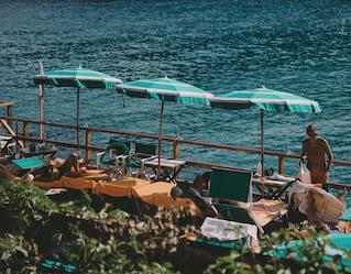 Sun loungers and parasols at Bay of Paraggi