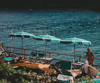 Parasols and sun loungers by the Portofino sea