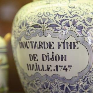 Blue-patterned ceramic jar labelled with 'Moutarde Fine de Dijon Maille 1747'