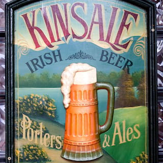 Sign reading 'Kinsale Irish Beer', with an overflowing beer glass illustration