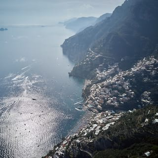 Villages of the Amalfi Coast spread across hilltops overlooking a glittering blue sea