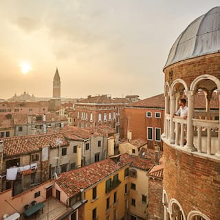 View from Scala del Bovolo across the Venetian skyline at sunset