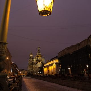 The domes of the Church of Saviour on the Spilled Blood against a night sky