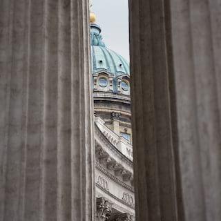View between two corinthian columns of a copper plated cathedral dome