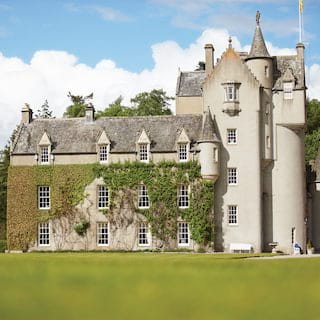 Ivy-coated romantic Scottish fairytale castle with traditional turrets