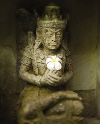 Traditional smiling Balinese statuette