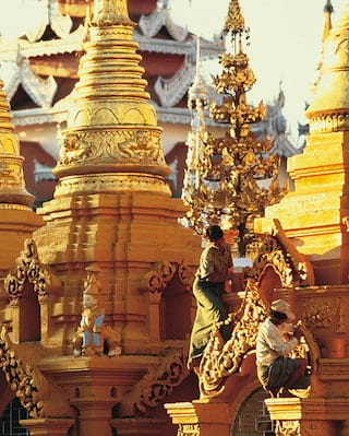 Painters restoring the ornate temples of Shwedagon Pagoda