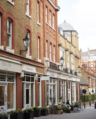 A Chelsea high-street lined with luxury boutiques, cafes and delicatessens