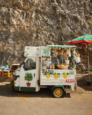 Ape Calessino car converted into a lemonade stand and painted with lemon patterns