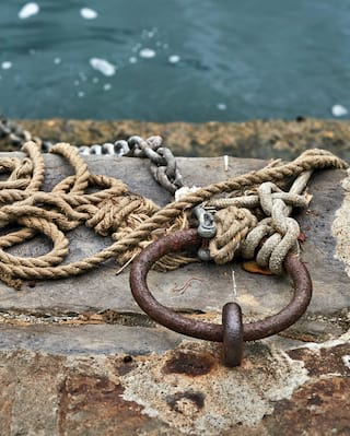 Old rusty metal and ropes on Portofino harbour
