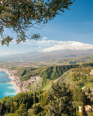 view of taormina, including mount etna in the distance