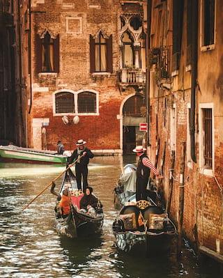 people on a gondola in venice