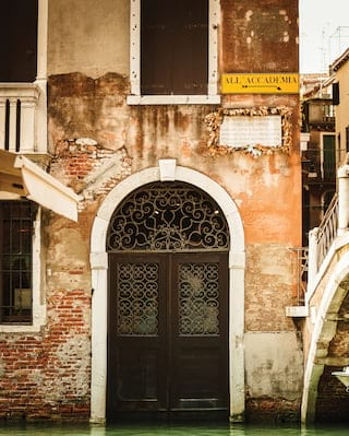 Exterior of a traditional house by lagoon in Venice