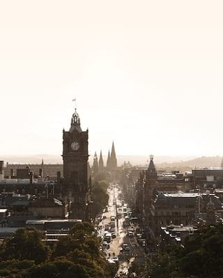 Aerial view of the Royal Mile and Edinburgh skyline under a sunny sky