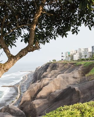 The wavy cliffs of the Lima shoreline with a curvy road sweeping along the base