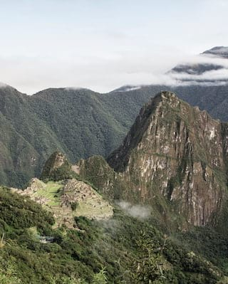 Aerial view of Machu Picchu landscape and jungle coated mountains
