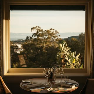 Restaurant table with views across Santa Barbara through windows beyond