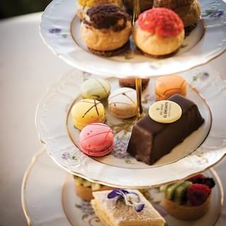 Tiered afternoon-tea platter with brightly colored varied confectionary