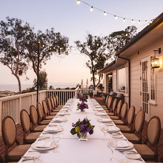 Banquet table on a balcony overlooking Santa Barbara at sunset