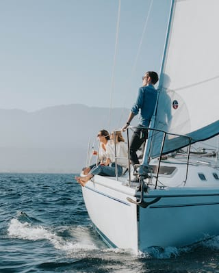 Friends relaxing on a sailing boat in the Pacific Ocean
