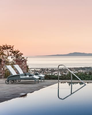 Zero-edge pool with a view of sunset over Santa Barbara and Pacific Ocean