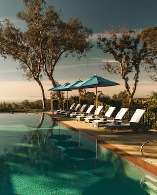 El Encanto Anniversary Offer - view of the pool at sunset