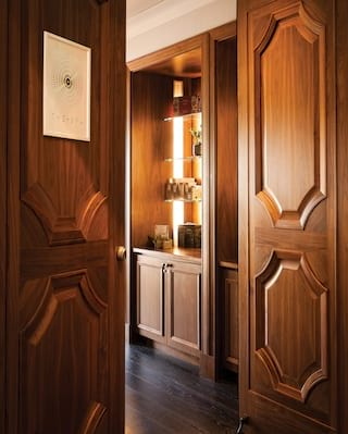Open wood-paneled spa entrance doors with a sign reading 'The Spa'