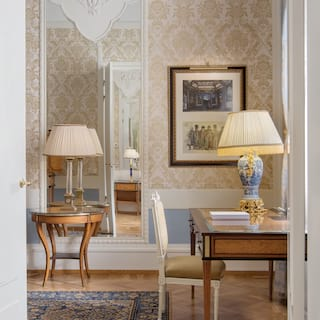 View through double doors of an elegant hotel room in the art nouveau style