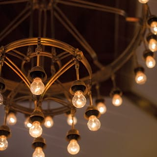 Close-up of pendant bulbs hanging from an avant-garde chandelier