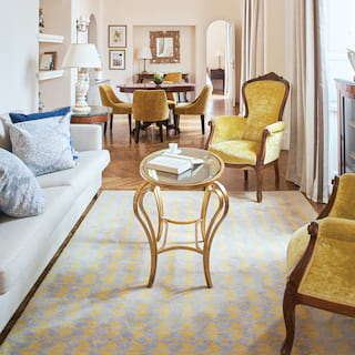 Stylish lounge area with plush armchairs and a sofa in pastel yellow and blue