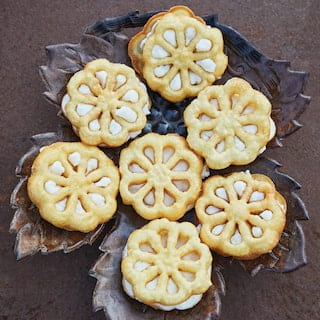 Birds-eye-view of flower shaped biscuits served on a ceramic leaf platter