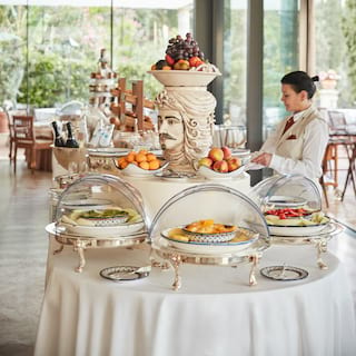 Breakfast buffet around a statue centrepiece in a light an airy restaurant