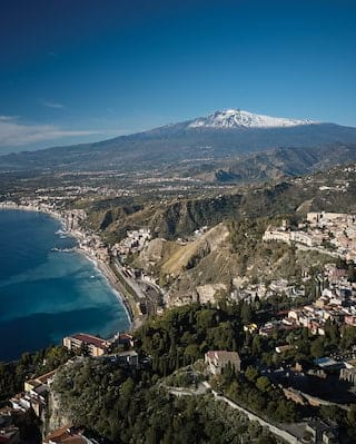 Aerial view of Taormina with Mount Etna in the background