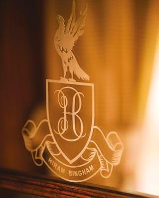 Close-up of the Belmond Hiram Bingham insignia on a glass mirror