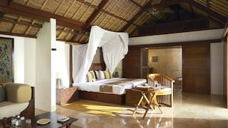 Interior of a spacious thatched roof villa with polished marble tile floors