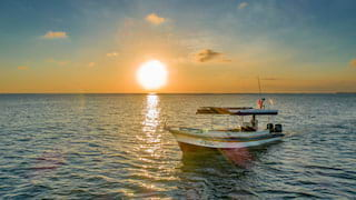 Boat at sunset on Jimbaran Bay