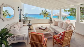 Sheltered terrace seating area overlooking the Caribbean sea