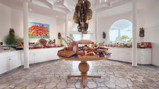 An abundant buffet breakfast in a light, circular room with a round centre table