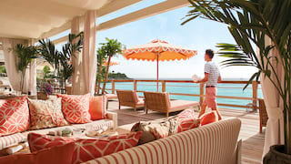 Dining terrace sofa seating area with views of the Caribbean sea