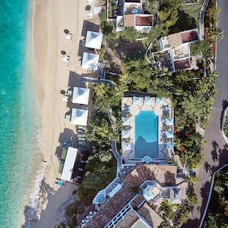Birds-eye view of Belmond La Samanna on cliffs above Baie Longue