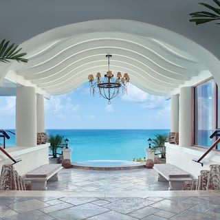Stone tiled entrance hall with vaulted archway and Caribbean sea beyond
